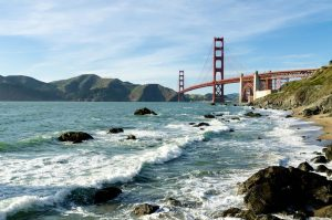 Picture of the ocean with the golden gate bridge in the backround