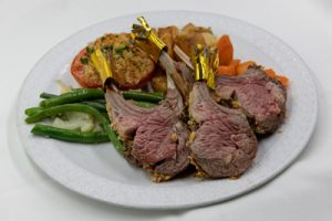 Plate of lamb chops with green beans and carrots